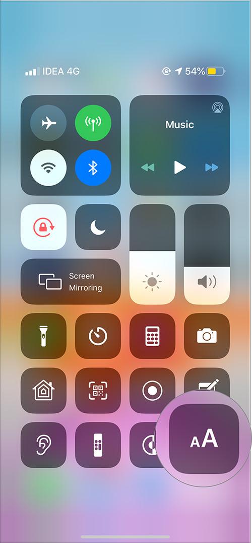 Toque el ícono Tamaño de texto en el Centro de control en iPhone 11 Max