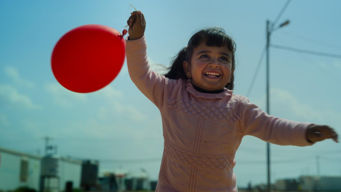 A 3un niño de un año del campo de refugiados de Zaatari en Jordania en
